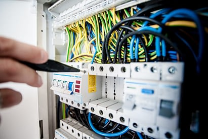 Electrician Checking Electric Board